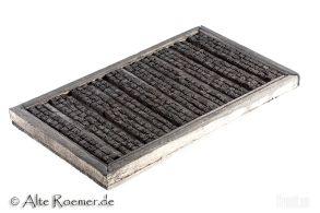 Chinesische Holzbuchstaben in Setzkasten